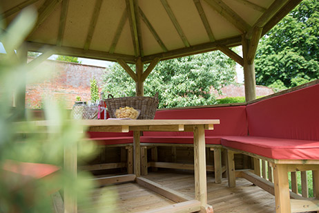 garden gazebo summer house timber range from M&M TImber with red cushions